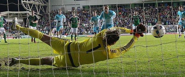 Roy Carroll stretches to save Milivoje Novakovic's penalty at Windsor Park