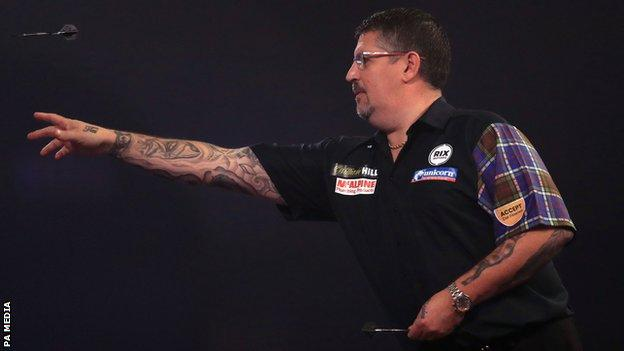 Scotland's Gary Anderson throws a dart during his third-round match against Madars Razma at the PDC World Championship