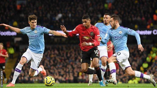 Man Utd forward Marcus Rashford (middle)