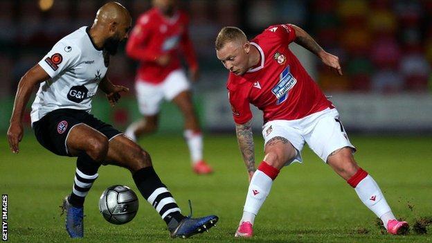Wrexham's Elliott Durrell takes on Maidenhead goalscorer Josh Coley.