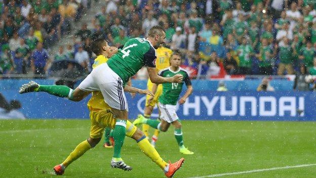Gareth McAuley heads Northern Ireland in front against Ukraine
