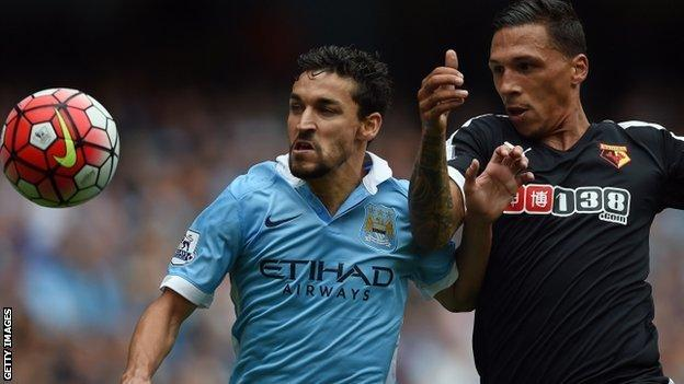 Man City winger Jesus Navas and Watford defender Jose Holebas