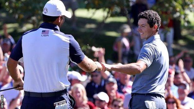 Patrick Reed and Rory McIlroy 'fist bump' on the eighth green