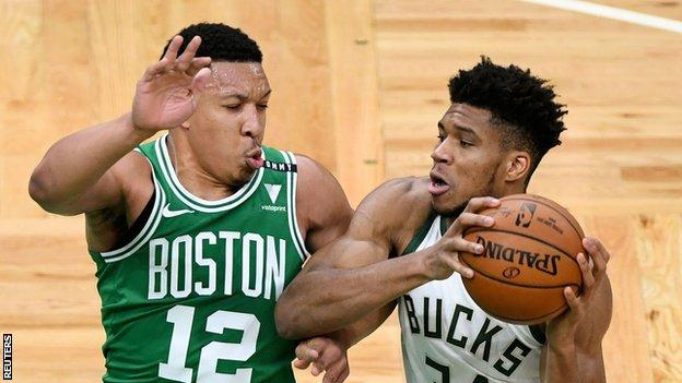 Milwaukee Bucks forward Giannis Antetokounmpo (34) drives to the basket against Boston Celtics forward Grant Williams (12)