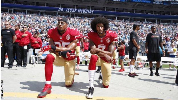 Eric Reid and Colin Kaepernick kneel for the national anthem