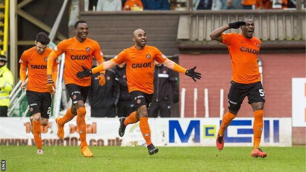 Dundee United players celebrate Guy Demel's opening goal in their win over Hearts