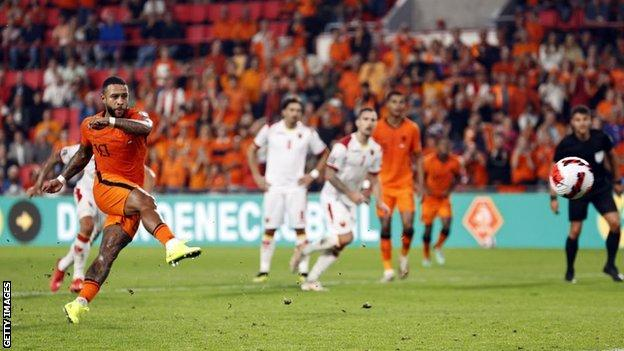 Memphis Depay scores from the penalty spot for the Netherlands against Montenegro