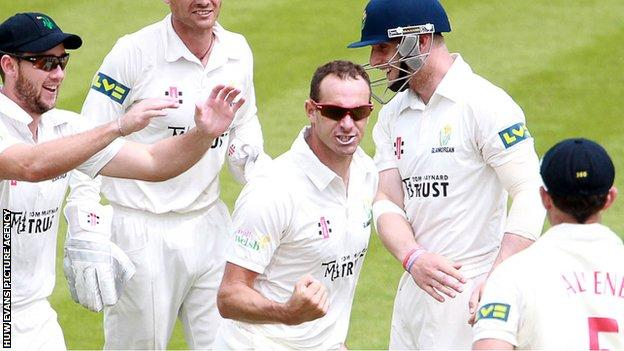 Dean Cosker celebrates with his Glamorgan team-mates