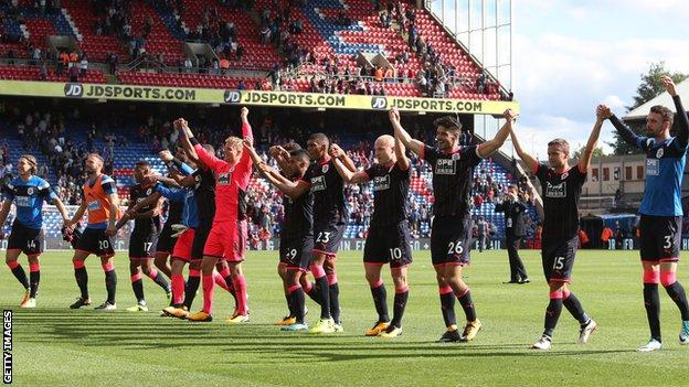 Huddersfield celebrate their first Premier League win