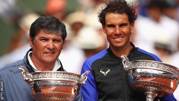 Toni Nadal and Rafael Nadal pose with trophies after their final French Open together in 2017