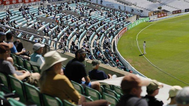 Spectators watch cricket
