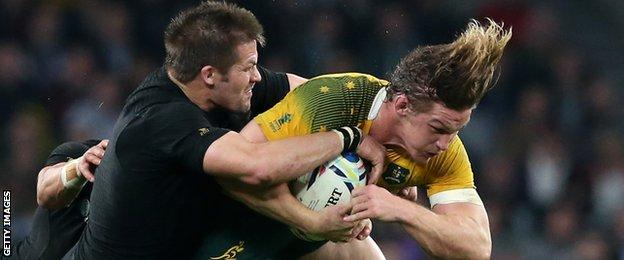 Richie McCaw tackles Michael Hooper in the World Cup final