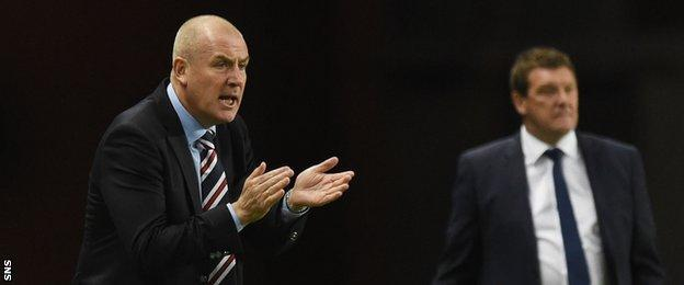 Mark Warburton urges his Rangers players on as Tommy Wright watches