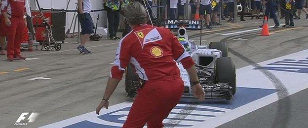 Ferrari team boss Maurizio Arrivabene is almost run over by Felipe Massa's Williams