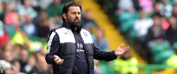 Paul Hartley looks on in horror as his Dundee team leak six goals