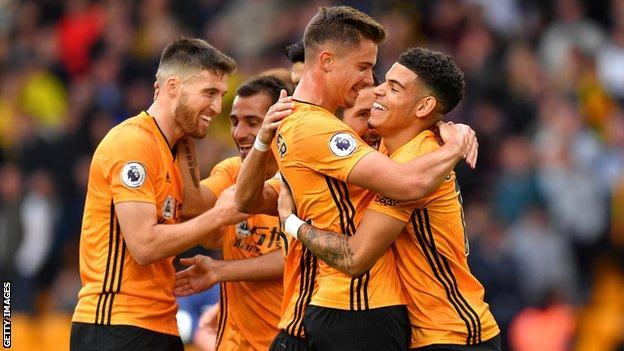 Wolves players celebrate their first win of the Premier League season