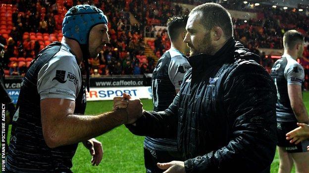 Opposing captains Justin Tipuric and Ken Owens shake hands after Scarlets 44-0 win over Ospreys