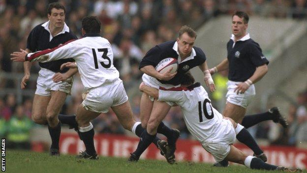 Scotland's Gregor Townsend is tackled by Rob Andrew of England