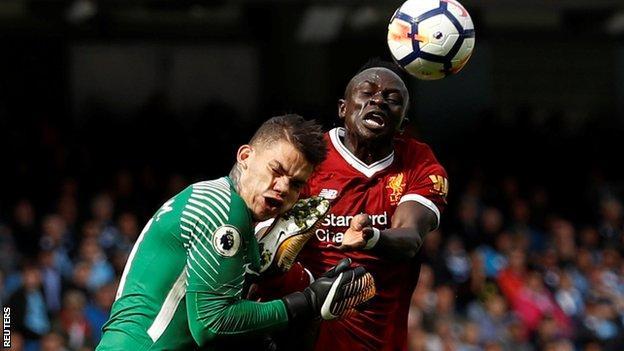 Sadio Mane clashes with Ederson