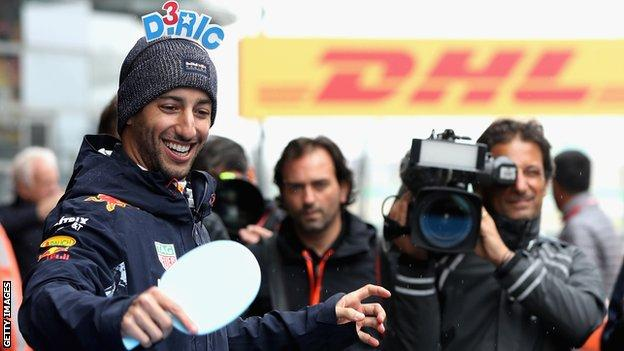 Red Bull driver Daniel Ricciardo plays table tennis ahead of the Chinese Grand Prix