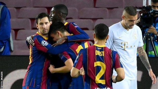 Lionel Messi (left) congratulates Pedri on scoring