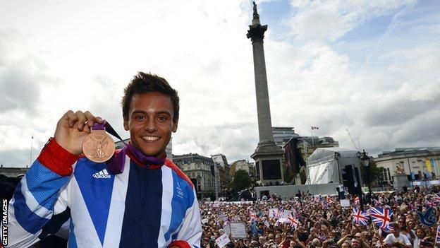 Tom Daley celebrates his bronze medal from London 2012