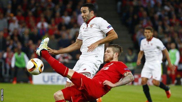 Liverpool left-back Alberto Moreno in action against Sevilla