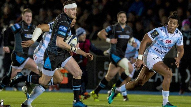 Finn Russell on the attack for Glasgow Warriors against Racing 92
