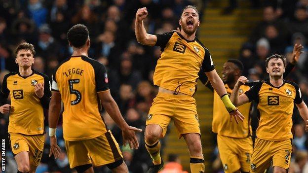 Port Vale's Tom Pope celebrates scoring against Manchester City