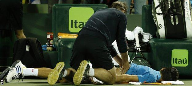 Djokovic gets treatment on his back