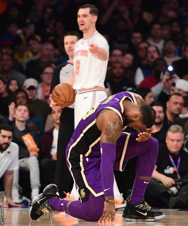 New York Knicks player Mario Hezonja points and laughs at LeBron James after fouling the Los Angeles Lakers forward