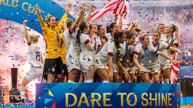 The United States celebrate with the trophy