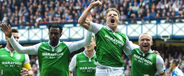 Hibs players celebrate at Ibrox after beating Rangers