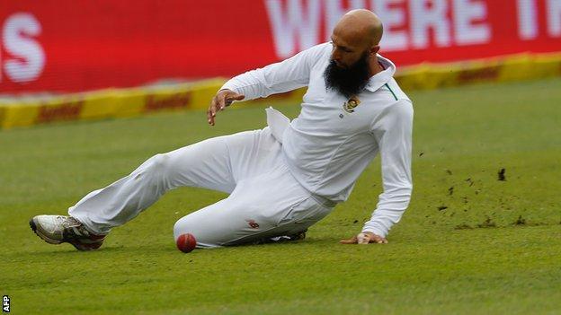 Hashim Amla slides in the field