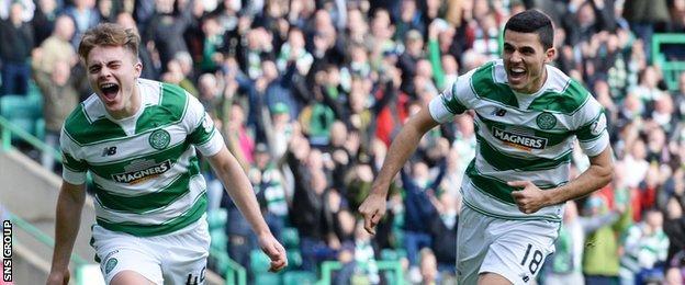 James Forrest (left) made it 3-0 to Celtic