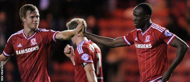 Tomas Kalas celebrates with Albert Adomah