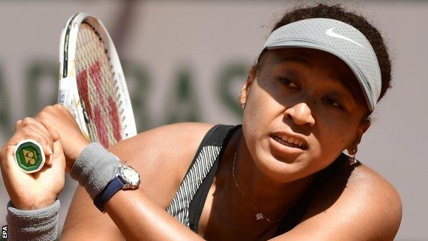 Naomi Osaka returns a ball at the French Open