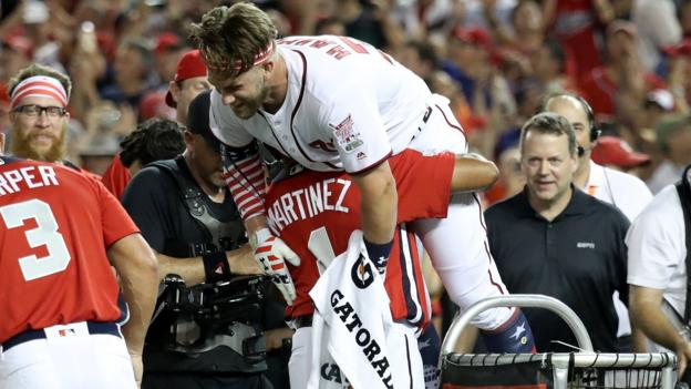 Baseball - WASHINGTON, DC - JULY 16: Bryce Harper of the Washington Nationals and National League celebrates with his manager Dave Martinez after winning the T-Mobile Home Run Derby at Nationals Park on July 16, 2018 in Washington, DC. (Photo by Rob Carr/Getty Images)