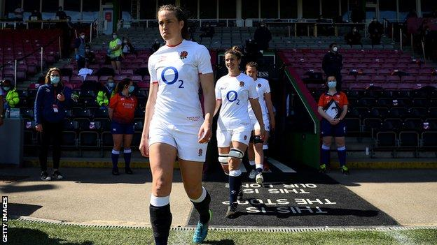 Emily Scarratt leads out the England team
