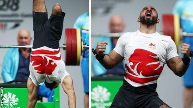 Ali Jawad celebrates a successful lift with a handstand