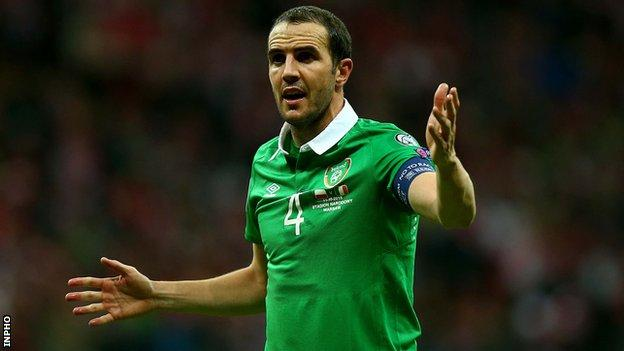 Republic of Ireland captain John O'Shea will be suspended for the first leg of the team's Euro 2016 play-off