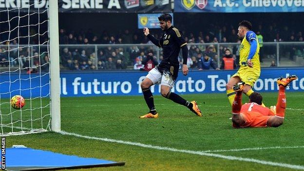 Juventus forward Alvaro Morata scores against Chievo