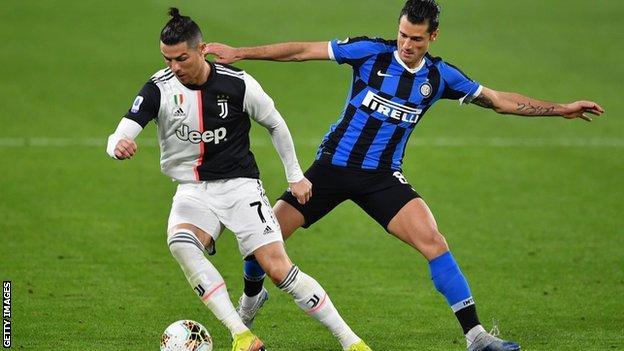 Cristiano Ronaldo of Juventus and Antonio Candreva of Inter Milan challenge for the ball
