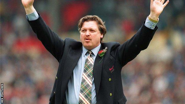 Knighton, pictured in 1995 addressing Carlisle fans