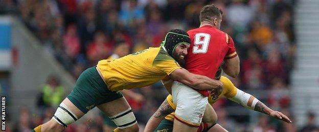 Australia's Scott Fardy tackles Wales scrum-half Gareth Davies