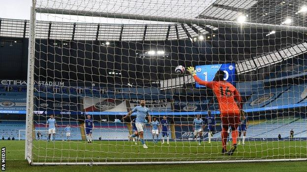 Sergio Aguero's penalty is saved by Chelsea goalkeeper Edouard Mendy. Aguero misses penalty