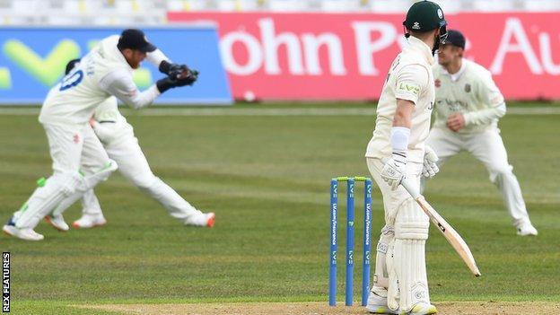 Durham wicketkeeper Stuart Poynter catches Nottinghamshire batsman Ben Duckett