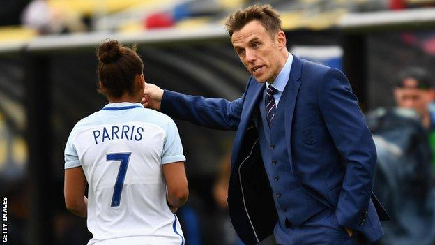 England women's head coach Phil Neville gives instructions to Nikita Parris on the sidelines