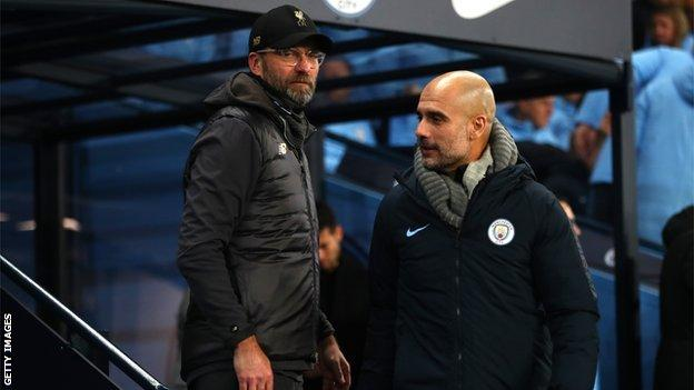 Liverpool manager Jurgen Klopp (left) and Manchester City's Pep Guardiola