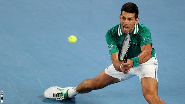 Novak Djokovic returns in the Australian Open quarter-final against Alexander Zverev